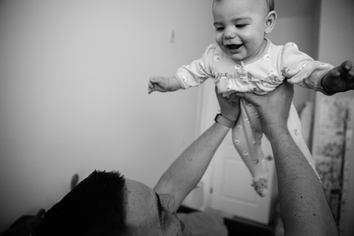 Father Making Baby Daughter Fly