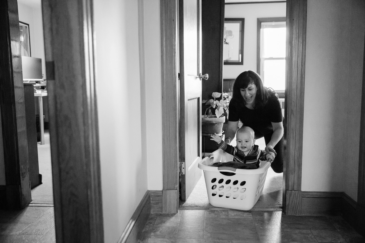 Mother Pushing Baby In Laundry Basket