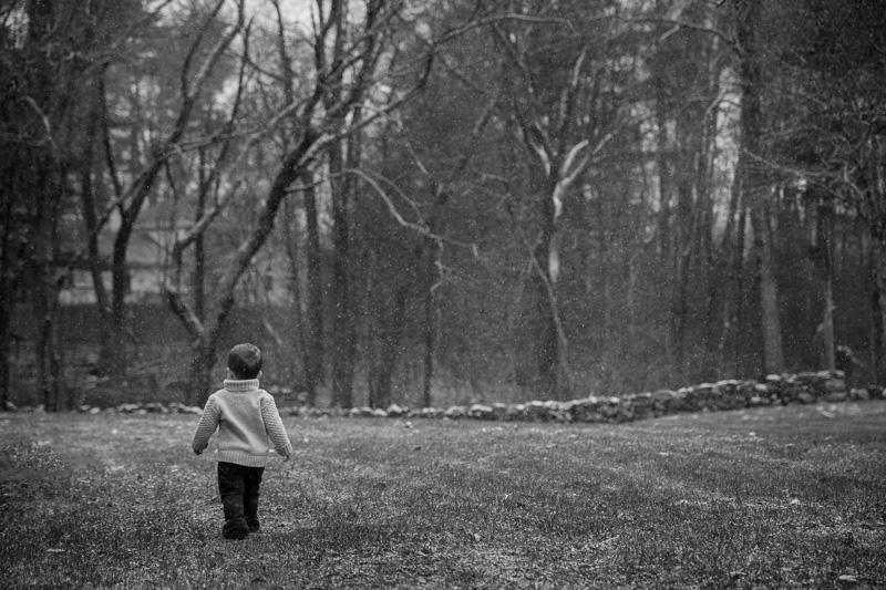 Boy Walking in Snow
